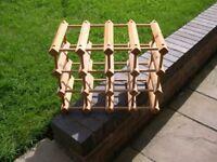A medium size wooden wine rack.
