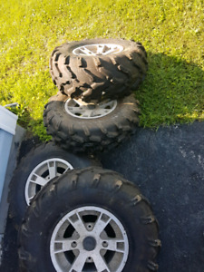 Ser of 4 stock 26inch tires and rims off 2008 can am outlander