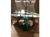 Round glass dining table has shade green very heavy all stand cut in design beautiful few marks top