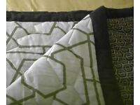 NEXT as new reversible lightweight quilt efect throw with piped edges.