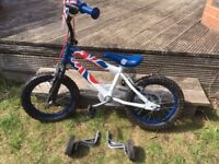 Young child's bike with stabilizers