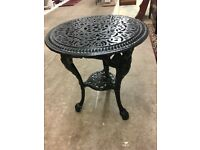 Cast iron garden table. Excellent condition in black
