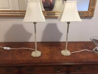 Two cream bedside lamps