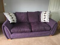 Purple 3 seater sofa and armchair as new condition