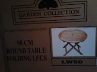 Still in their boxes! One hardwood table and four matching chairs