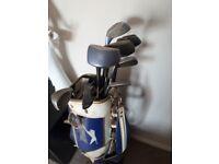 Set of golf clubs in a Slazenger bag