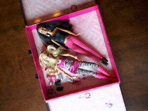 Two rocking Barbies in a carry case