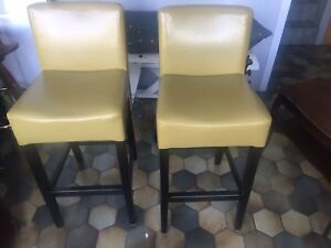 Green leather bar stools (two)