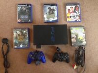 PS2 console with games and 2 controllers