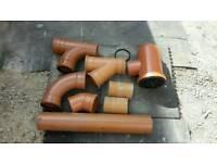 Selection of orange underground waste drainage fittings