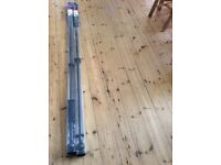 Two black curtain poles in box