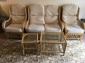Cane conservatory furniture-two seater and two arm chairs and two tables. good condition