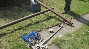 clothes line pole, wire, pulleys and line tensioner