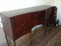 Graceful reproduction antique sideboard with plush lined cutlery drawer plus another deep drawer