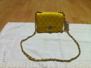 Brand New Chanel yellow leather mini flap bag, it's completely n