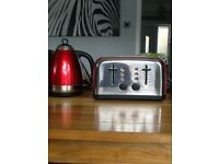 Kettle and toaster. Red. Little bit wear and tear but still in very good condition.