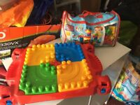 Mega Bloks collapsible table and huge bag of Bloks. Excellent condition.