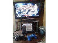 Black Slimline Playstation 2, 8 Games, 2 Controllers, 4 x 8 Mb Memory Cards, AV & Power Leads
