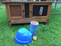 Almost brand new hutch with accesories and 2 baby female guinea pigs!