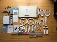Wii bundles with balacing board, accessories, manuals and 12 games