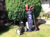 Set of ladies golf clubs, together with blue bag and trolley
