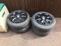 Vauxhall Corsa Steel wheels with black hub caps near new tires