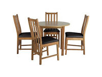 Elton Oak Circular Dining Table and 4 Black Chairs