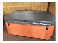 2 seater lay down jacuzzi hotub, which has lights that change colour and a Bluetooth speaker.