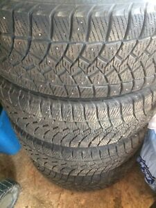 (4) 265-70-17 Studded Good Year Ultra Grip Tires w/ Dodge Rims