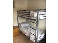 Silver metal bunk beds with mattresses