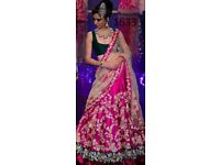 pink and green lehenga with embroidery in gold