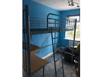 Metal bunk bed with wooden desk