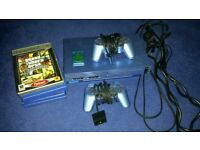 Limited edition aqua blue ps2 console and games