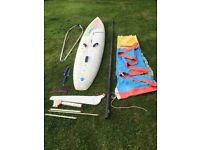 Windsurf board, mast and sail. Ten Cate Runner complete with foot straps, mast, and 5.8m sail