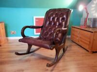 Leather burgundy rocking chair. Comfortable and stylish addition to the living room.