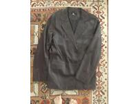 100% leather jacket - size 56.