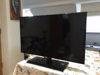 PS4 with Full HD 32 inch TV and 2 sealed games
