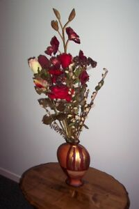 Vase with artifical flowers
