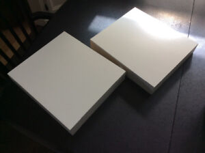 Two white IKEA Lack floating wall shelves