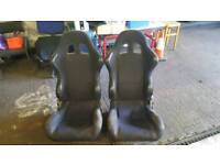 Black reclining bucket seats
