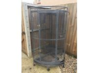 TWO PARROT CAGES FOR SALE. ONE HAS A LITTLE BIT OF RUST AT THE BOTTOM BUT WILL EASILY CLEAN UP.
