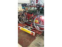 Towbar mounted bike rack with lighting board.