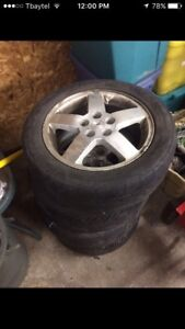 4 205/65/r16 tires with rims