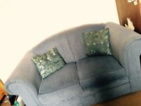 Blue two seater fabric sofa