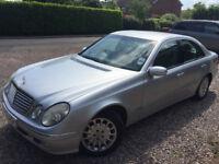 Silver Mercedes E320 CDI
