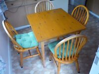Country style pine table and chairs.