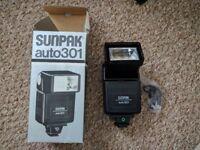 Sunpak Auto 301 and Nissin 360TW flash guns