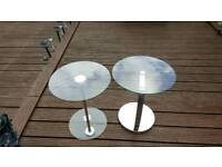 2 glass round tables