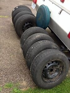 205/70R15 96T (4) winter and 4 all Season tires with rims