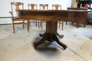 Antique oak pedestal table and chairs (sale pending)